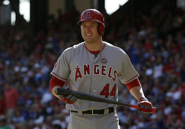 Los Angeles Angels' Mark Trumbo (44)walks back to the dugout after striking out against Texas Rangers relief pitcher Robbie Ross in the seventh inning of a baseball game, Sunday, Sept. 29, 2013, in Arlington, Texas. The Angels won 4-2. (AP Photo/Tony Gutierrez)