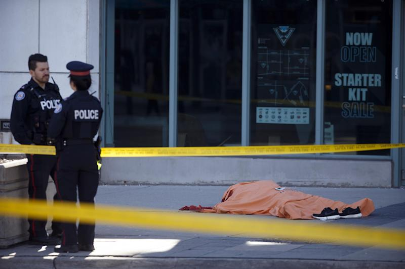 A tarp covers an unidentiified body on Yonge St. at Finch Ave. after a van plowed into pedestrians on April 23, 2018 in Toronto, Ontario, Canada: Cole Burston/Getty Images