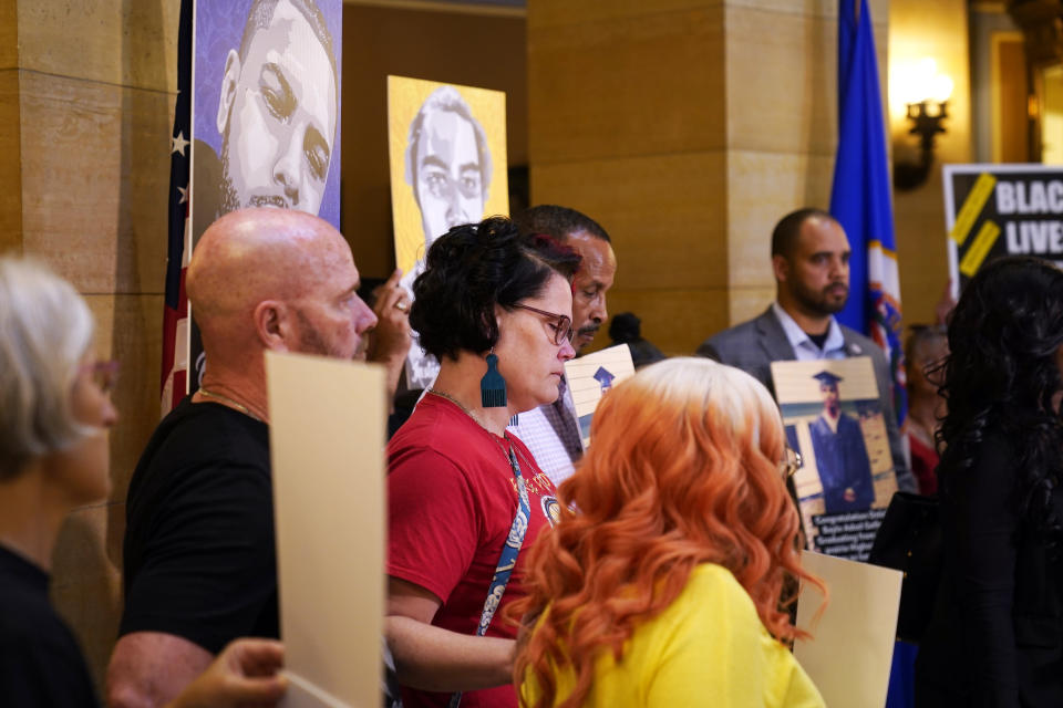 Protesters, including Courteney Ross, who was George Floyd's girlfriend, center, gather in the State Capitol rotunda ahead of the debate to urge the Minnesota House to reject the compromise and pass tougher measures in the Public Safety Bill, Tuesday, June 29, 2021, in St. Paul, Minn. (AP Photo/Jim Mone)