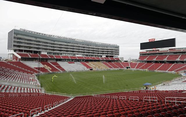 The newly-installed turf now covers the field at Levi's Stadium during a preview tour Monday, April 21, 2014, in Santa Clara, Calif. The installation of 2.5 acres of sod was completed over the weekend. The team selected West Coast Turf's Bandera Bermuda for the playing field. The new home of the San Francisco 49ers football team opens in August. (AP Photo/Eric Risberg)