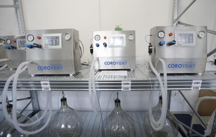 Lung ventilators manufactured in Trebic, Czech Republic, being tested on Wednesday, June 17, 2020. A group of volunteers in the Czech Republic was working round the clock to prevent critical shortage of ventilators for COVID-19 patients. A team of 30 developed a fully functional ventilator _ named Corovent _ in just days. They secured the necessary finances through crowdfunding, approached a leading expert in the field with a request for help and gave him all possible support. (AP Photo/Petr David Josek)
