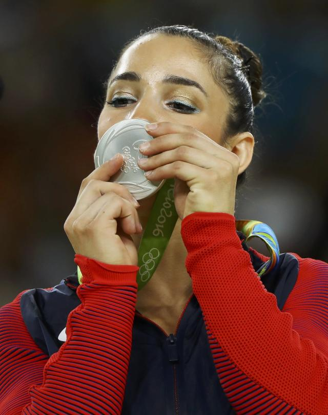 2016 Rio Olympics - Artistic Gymnastics - Victory Ceremony - Women's Floor Victory Ceremony - Rio Olympic Arena - Rio de Janeiro, Brazil - 16/08/2016. Alexandra Raisman (USA) of USA (Aly Raisman) looks at her silver medal on the podium. REUTERS/Mike Blake FOR EDITORIAL USE ONLY. NOT FOR SALE FOR MARKETING OR ADVERTISING CAMPAIGNS.