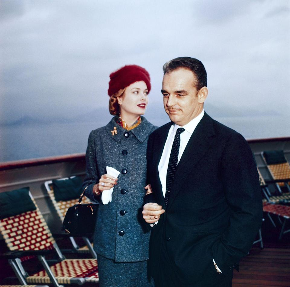 <p>This was the year that Grace Kelly became Princess of Monaco after she married Prince Rainier III. Here, she wears a burgundy velvet hat and slate gray suit for a November trip from the United States to France.<br></p>