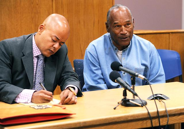 <p>O.J. Simpson (R) reacts at his parole hearing with attorney Malcolm LaVergne at Lovelock Correctional Centre in Lovelock, Nevada, U.S. July 20, 2017. (Jason Bean/Pool/Reuters) </p>