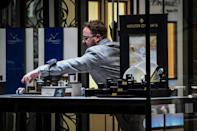 A member of staff removes stock from a jewellers shop window as shops close in the Argyle Arcade shopping centre on Buchanan Street in central Glasgow, ahead of the introduction of further coronavirus restrictions on November 20, 2020