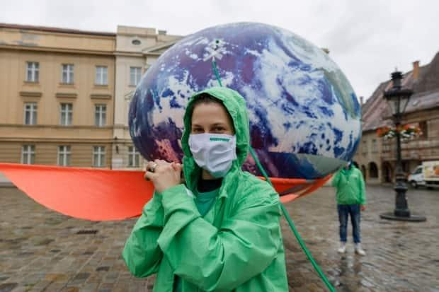 Greenpeace activists carry the installation Earth on IV Drip, in front of the Croatian parliament during the Green Recovery protest in June 2020, to draw attention to ecology in the Adriatic country. (Antonio Bronic/Reuters - image credit)