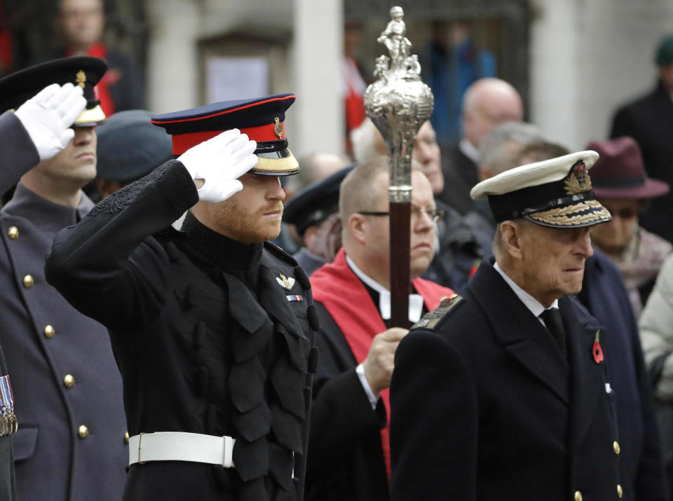 """FILE - In this file photo dated Thursday, Nov. 10, 2016, Britain's Prince Harry salutes as he and Prince Philip attend the official opening of the annual Field of Remembrance at Westminster Abbey in London. In the TV program 'Prince Philip: The Royal Family Remembers' released late Saturday Sept. 18, 2021, members of the royal family spoke admiringly of the late Duke of Edinburgh's barbecuing skills and Prince Harry described how his grandfather would """"never probe"""" but listen intently about his two tour of duties to Helmand province during the war in Afghanistan.(AP Photo/Matt Dunham)"""