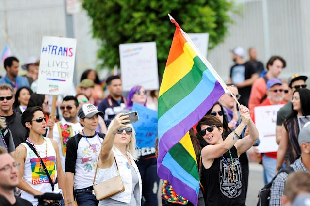 <p>People participate in a Resist March that replaced the annual Pride Parade in Los Angeles, Calif., on June 11, 2017. (Photo: Andrew Cullen/Reuters) </p>