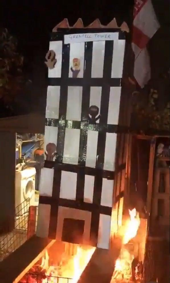 The video, which was seen by the High Court judges, showed figures being burned in a model of the west-London tower (PA Media)