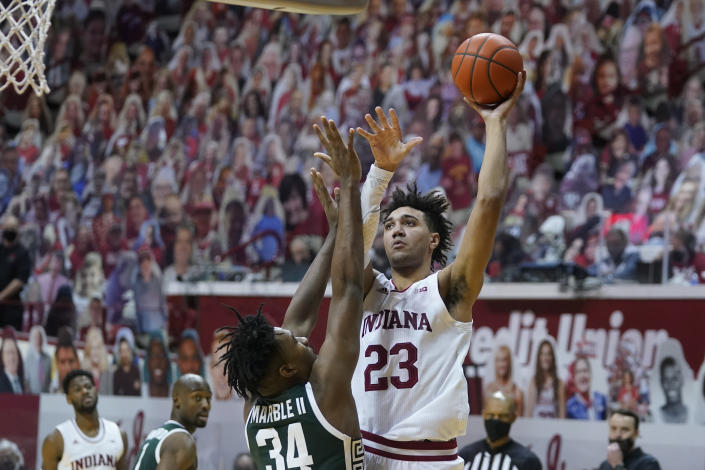 Indiana's Trayce Jackson-Davis (23) shoots over Michigan State's Julius Marble II (34) during the second half of an NCAA college basketball game, Saturday, Feb. 20, 2021, in Bloomington, Ind. Michigan State won 78-71. (AP Photo/Darron Cummings)