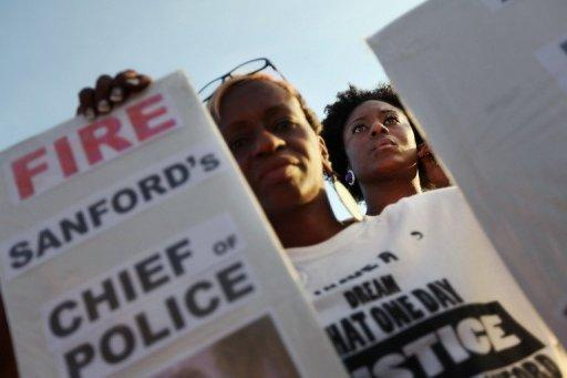 Protesters demonstrate at a rally for slain teenager Trayvon Martin on March 22, in Sanford, Florida. Thousands of people outraged by the fatal shooting of the unarmed black teenager by a white crime watch volunteer gathered to vent their anger and demand justice at a rally in the Florida town