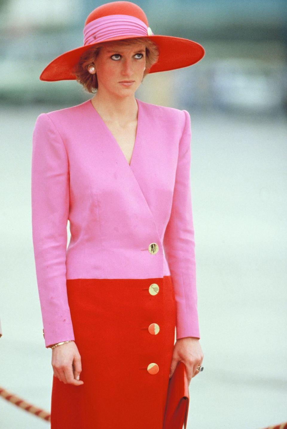 <p>Princess Diana in a pink-and-red Catherine Walker dress and a matching Philip Somerville hat on an official visit to Kuwait. </p>