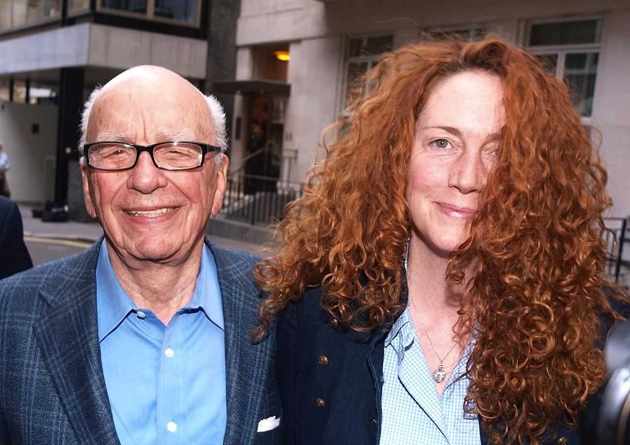 FILE - Chairman of News Corporation Rupert Murdoch, left, and Chief executive of News International Rebekah Brooks as they leave his residence in central London, in this Sunday, July 10, 2011 file photo. Brooks resigned as Chief executive of News International Friday July 15, 2011 according to News International journalists. (AP Photo/Ian Nicholson) UNITED KINGDOM OUT - NO SALES - NO ARCHIVES