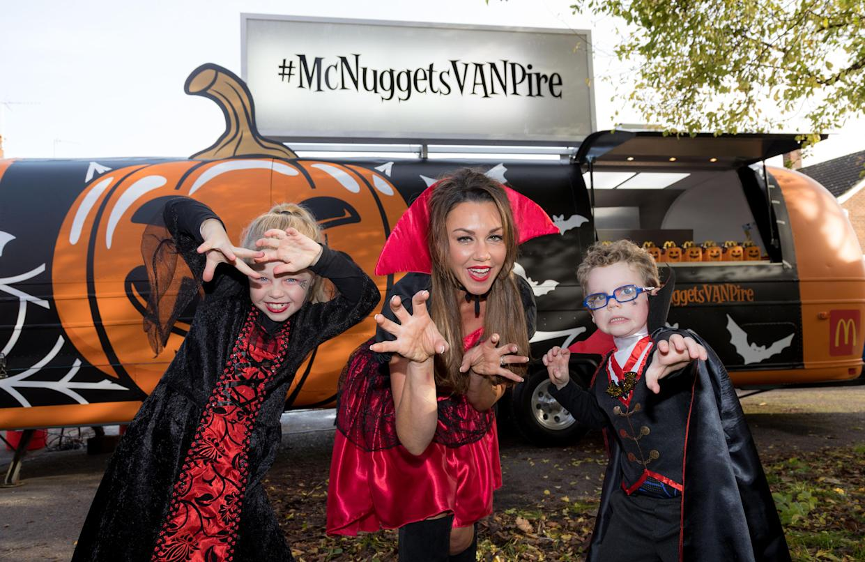 Michelle Heaton and her children Faith and AJ attend McDonald's #McNuggetsVANPire Halloween party in Southampton. PA Photo. Picture date: Sunday October 27, 2019. In McDonaldÕs restaurants and drive-thrus up and down the UK until 31st October, children can also enjoy Limited-Edition McDonaldÕs Halloween activity packs which include scary masks, balloons, stickers, a creepy colouring-in tablecloth and crayons. Photo credit should read: Paul Harding/PA Wire (Photo by Paul Harding/PA Images via Getty Images)