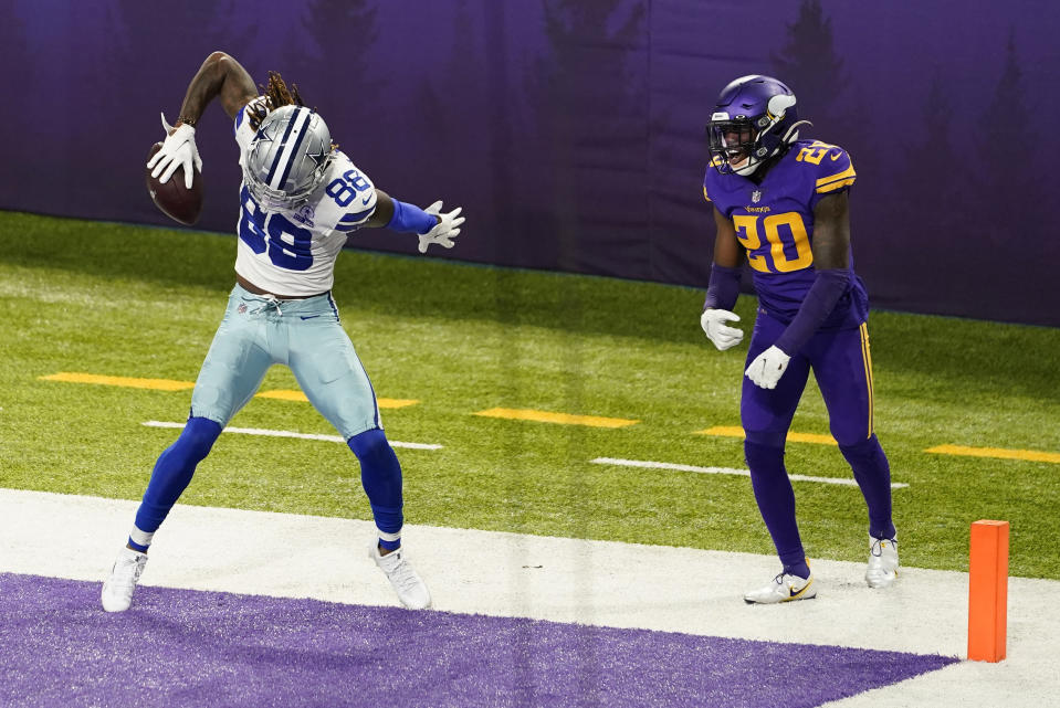 Dallas Cowboys wide receiver CeeDee Lamb (88) celebrates in front of Minnesota Vikings cornerback Jeff Gladney after scoring a touchdown. (AP Photo/Jim Mone)