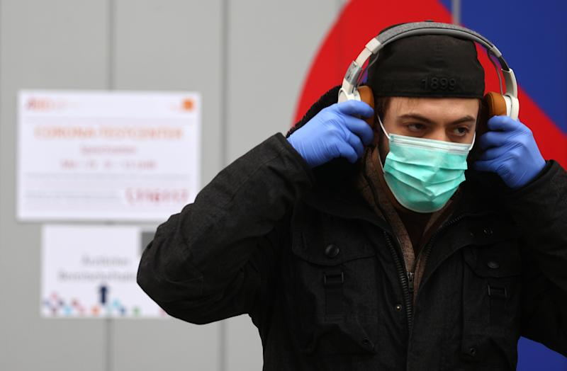 A man leaves a coronavirus (COVID-19) test center in Frankfurt, Germany, March 17, 2020. REUTERS/Kai Pfaffenbach