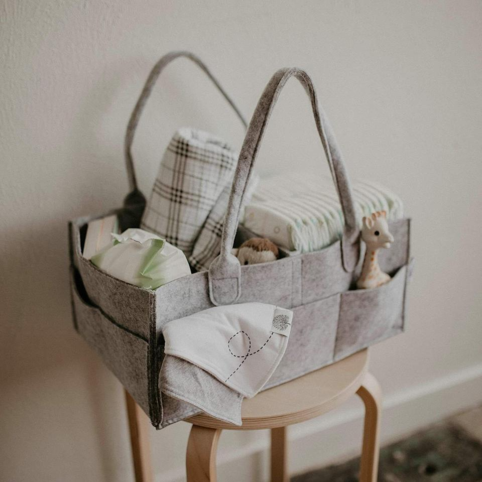 """Designed with adjustable pockets, you'll be able to fit everything you need in a neat, orderly and travel-friendly fashion.<br /><br /><strong>Promising review:</strong>""""This caddy is great! I ordered the larger size and it holds a ton of stuff. I use it daily to carry my daughter's diapers and other changing essentials from upstairs to downstairs. It's sturdy, spacious, and has a simple, attractive design which is exactly what I wanted. There are three small pockets and two large pockets on the sides of the caddy.<strong>The inside separator is detachable so you can arrange the sections however works best for you.</strong>The handles are a nice length — it's very easy to pick up.<strong>This is one of my favorite baby purchases I've made and I highly recommend it</strong>."""" —<a href=""""https://amzn.to/3aeIW4k"""" target=""""_blank"""" rel=""""nofollow noopener noreferrer"""" data-skimlinks-tracking=""""5902331"""" data-vars-affiliate=""""Amazon"""" data-vars-href=""""https://www.amazon.com/gp/customer-reviews/RWJWYYFFR8I12?tag=bfmal-20&ascsubtag=5902331%2C11%2C37%2Cmobile_web%2C0%2C0%2C16540723"""" data-vars-keywords=""""cleaning,fast fashion"""" data-vars-link-id=""""16540723"""" data-vars-price="""""""" data-vars-product-id=""""20969690"""" data-vars-product-img="""""""" data-vars-product-title="""""""" data-vars-retailers=""""Amazon"""">Zoe</a><br /><br /><strong>Get it from Amazon for<a href=""""https://amzn.to/3sl10Qr"""" target=""""_blank"""" rel=""""nofollow noopener noreferrer"""" data-skimlinks-tracking=""""5902331"""" data-vars-affiliate=""""Amazon"""" data-vars-asin=""""B075JS5R1J"""" data-vars-href=""""https://www.amazon.com/dp/B075JS5R1J?tag=bfmal-20&ascsubtag=5902331%2C11%2C37%2Cmobile_web%2C0%2C0%2C16540692"""" data-vars-keywords=""""cleaning,fast fashion"""" data-vars-link-id=""""16540692"""" data-vars-price="""""""" data-vars-product-id=""""18323843"""" data-vars-product-img=""""https://m.media-amazon.com/images/I/41rYnjpMxvL._SL500_.jpg"""" data-vars-product-title=""""Parker Baby Diaper Caddy - Nursery Storage Bin and Car Organizer for Diapers and Baby Wipes - Large"""" data-vars-retailers=""""Amazon"""">"""