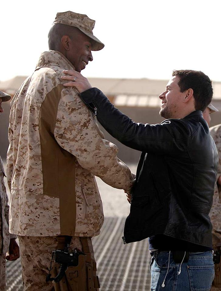 """Though he might be a Hollywood heavyweight these days, there are still people """"The Fighter"""" star Mark Wahlberg has to look up to. The actor was snapped shaking hands with Major Larry Parker during his trip to Camp Leatherneck in Afghanistan while on a goodwill mission to visit the troops. US Marine Corps/<a href=""""http://www.splashnewsonline.com"""" target=""""new"""">Splash News</a>"""