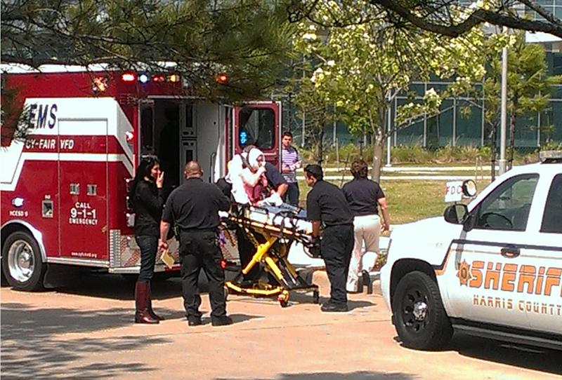 In this photo provided by Teaundrae Perryman, a victim is loaded into an ambulance after being wounded in a stabbing attack on the Lone Star community college system's Cypress, Texas campus Tuesday, April 9, 2013. At least 14 people were wounded when a suspect went building-to-building in an apparent stabbing attack at the college campus authorities said. (AP Photo/Teaundrae Perryman)