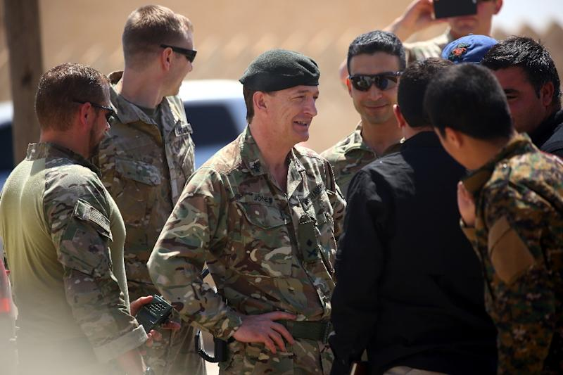 Rupert Jones (C), deputy commander of Combined Joint Task Force – Operation Inherent Resolve (CJTF-OIR), arrives for a meeting with the Raqa Civil Council on July 23, 2017, in the northern Syrian village of Ain Issa