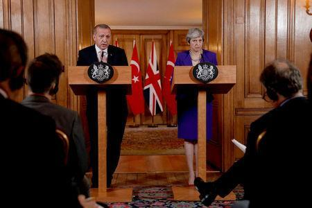Turkey's President Recep Tayyip Erdogan and British Prime Minister Theresa May take part in a news conference after their meeting at 10 Downing Street in London, Britain, May 15, 2018. Matt Dunham/Pool via REUTERS