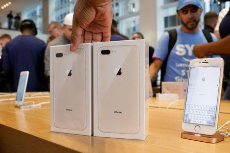 Two new iPhone 8's are placed out during a sale at the 5th Avenue Apple store in New York
