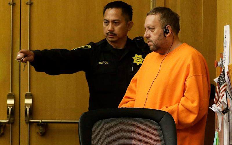 Andrew Warren, right, enters a courtroom for an extradition hearing at the Hall of Justice in San Francisco - AP