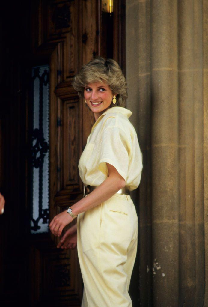 <p>Diana matched her gold jewelry with a chunky metallic gold belt while vacationing in Majorca, Spain in August 1987. </p>