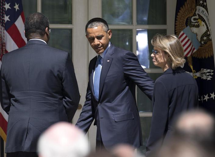 President Barack Obama, center, walks towards the Oval Office, following the announcement of the nominations of Robert Wilkins, left, Cornelia Pillard, right, and Patricia Ann Millet, not in picture, to the U.S. Court of Appeals for the District of Columbia Circuit, Tuesday, June 4, 2013, in the Rose Garden of the White House in Washington. (AP Photo/Manuel Balce Ceneta)
