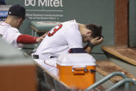 Boston Red Sox's Michael Chavis sits in the dugout as he is consoled by a teammate after he struck out for the fifth time for the final out of the team's loss to the Philadelphia Phillies in a baseball game Tuesday, Aug. 18, 2020, at Fenway Park in Boston. (AP Photo/Winslow Townson)