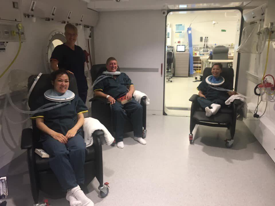 Andrew Dunn with two others from the boat inside the chamber at Fiona Stanley Hospital following their carbon monoxide poisoning.