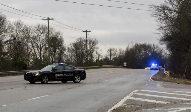 <p>West Columbia police direct people away from the site of an early morning train crash, Feb. 4, 2018, in Cayce, SC. (Photo: Jeff Blake/AP) </p>
