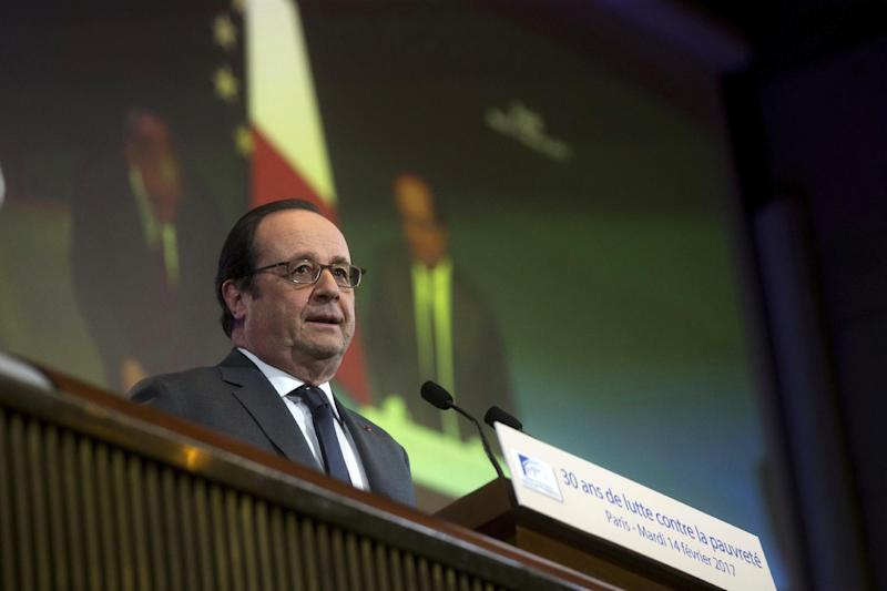 France's President Francois Hollande delivers a speech during a conference on poverty at the French Economic, Social and Environmental Council (CESE), in Paris, Tuesday, Feb. 14, 2017. (AP Photo/Thibault Camus, Pool)