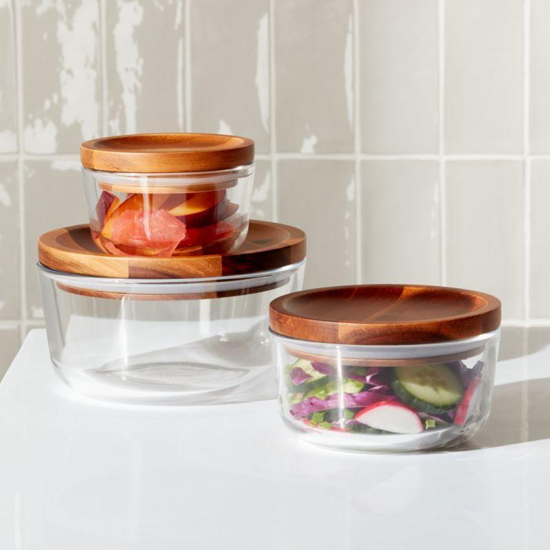 """<p><strong>pyrex</strong></p><p>crateandbarrel.com</p><p><strong>$34.99</strong></p><p><a href=""""https://go.redirectingat.com?id=74968X1596630&url=https%3A%2F%2Fwww.crateandbarrel.com%2Fpyrex-wood-lid-storage-6-piece-set%2Fs295435&sref=https%3A%2F%2Fwww.thepioneerwoman.com%2Fhome-lifestyle%2Fdecorating-ideas%2Fg33901854%2Fbest-food-storage-containers%2F"""" rel=""""nofollow noopener"""" target=""""_blank"""" data-ylk=""""slk:Shop Now"""" class=""""link rapid-noclick-resp"""">Shop Now</a></p><p>Pyrex has always been notorious for their fun food containers, but these are flat-out chic. They're made of glass and acacia wood and come in a one, two, and four cup set. </p>"""