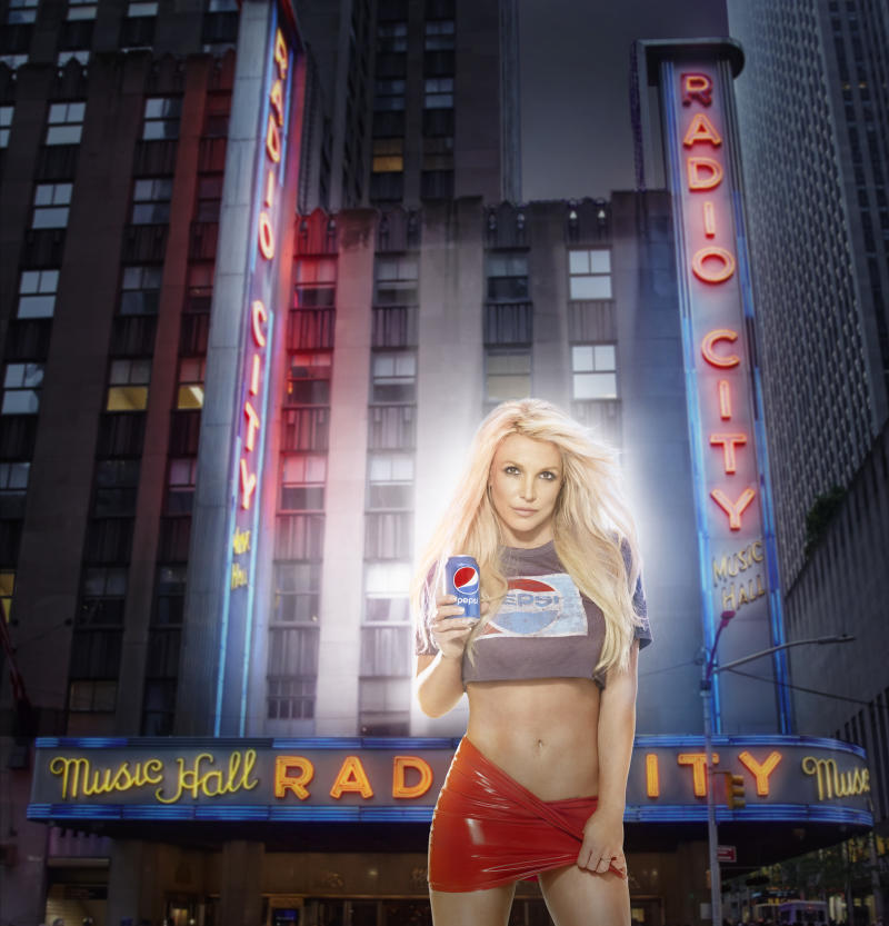 In honor of the historic partnership announcement between The Madison Square Garden Company and PepsiCo, longtime Pepsi musical artist Britney Spears pictured here in front of Radio City Music Hall.
