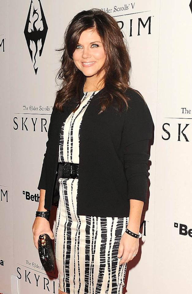 """Actress Tiffani Thiessen was chic in a black-and-white dress by Rachel Roy. The """"White Collar"""" star was still beaming after her USA show was  nominated for a People's Choice Award that day. (11/8/2011)"""