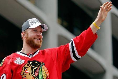 Jun 18, 2015; Chicago, IL, USA; Chicago Blackhawks left wing Bryan Bickell (29) acknowledges the crowd during the 2015 Stanley Cup championship parade and rally at Soldier Field. Mandatory Credit: Jon Durr-USA TODAY Sports