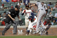 Atlanta Braves' Guillermo Heredia (38) slides safely to score on a wild pitch by San Francisco Giants' Sammy Long (73) in the eighth inning of a baseball game Sunday, Aug. 29, 2021, in Atlanta. Giants catcher Curt Casali, right, and home plate umpire Chris Segal (96) looks on. (AP Photo/Ben Margot)