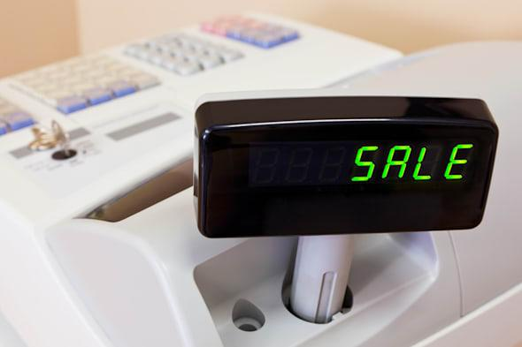 the word sale on the display of ...