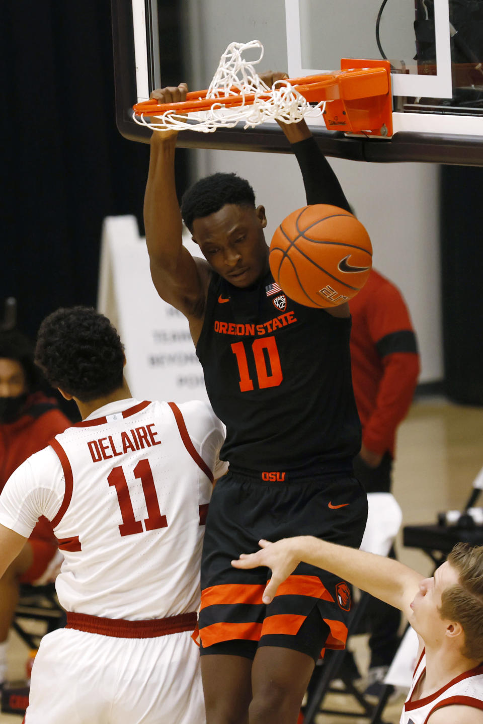 Oregon State forward Warith Alatishe (10) dunks in front ofStanford forward Jaiden Delaire (11) during the first half of an NCAA college basketball game in Stanford, Calif., Saturday, Feb. 27, 2021. (AP Photo/Josie Lepe)