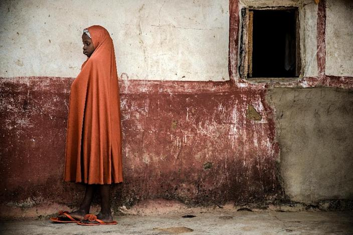 A Fulani girl waits outside her home at Kachia, a reserve for pastoralists in Kaduna state (AFP Photo/Luis TATO)
