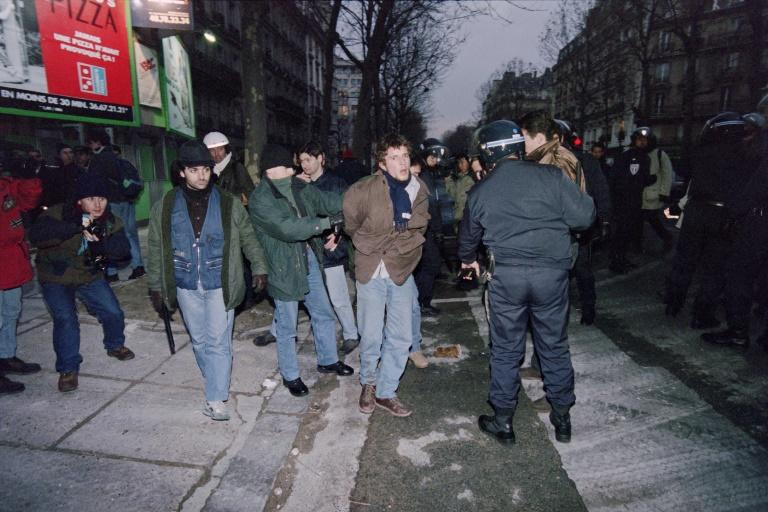 Police make an arrest in a 1995 Paris demonstration during the national strike movement against cuts to welfare and pensions systems