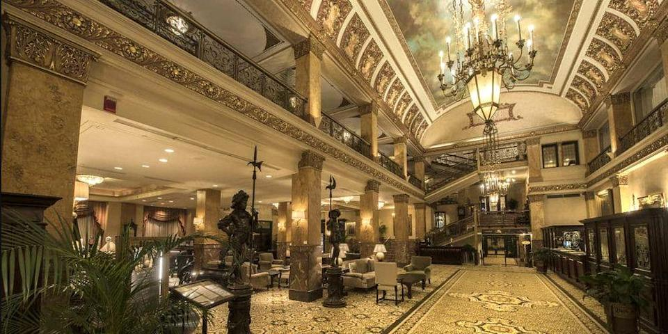"""<p><a href=""""https://go.redirectingat.com?id=74968X1596630&url=https%3A%2F%2Fwww.tripadvisor.com%2FHotel_Review-g60097-d101022-Reviews-The_Pfister_Hotel-Milwaukee_Wisconsin.html&sref=https%3A%2F%2Fwww.redbookmag.com%2Fabout%2Fg34149750%2Fmost-historic-hotels%2F"""" rel=""""nofollow noopener"""" target=""""_blank"""" data-ylk=""""slk:The Pfister"""" class=""""link rapid-noclick-resp"""">The Pfister</a> in Milwaukee is a Victorian gem opened in 1893 by businessman Guido Pfister. The centerpiece is the grand lobby, famous for its trompe l'oeil ceiling. Atop the hotel's 23-story tower (added in 1965) is a modern cocktail lounge offering stellar Lake Michigan views. </p>"""