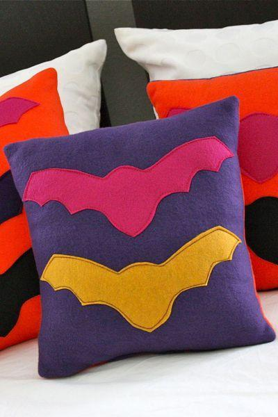 """<p>Your kids will go batty for this fun and colorful pillow project, which they can proudly display for cool bedroom Halloween decor.</p><p><strong>Get the tutorial at <a href=""""http://www.madeeveryday.com/2011/10/tutorial-bright-bat-pillows.html/"""" rel=""""nofollow noopener"""" target=""""_blank"""" data-ylk=""""slk:Made Everyday"""" class=""""link rapid-noclick-resp"""">Made Everyday</a>.</strong> </p>"""