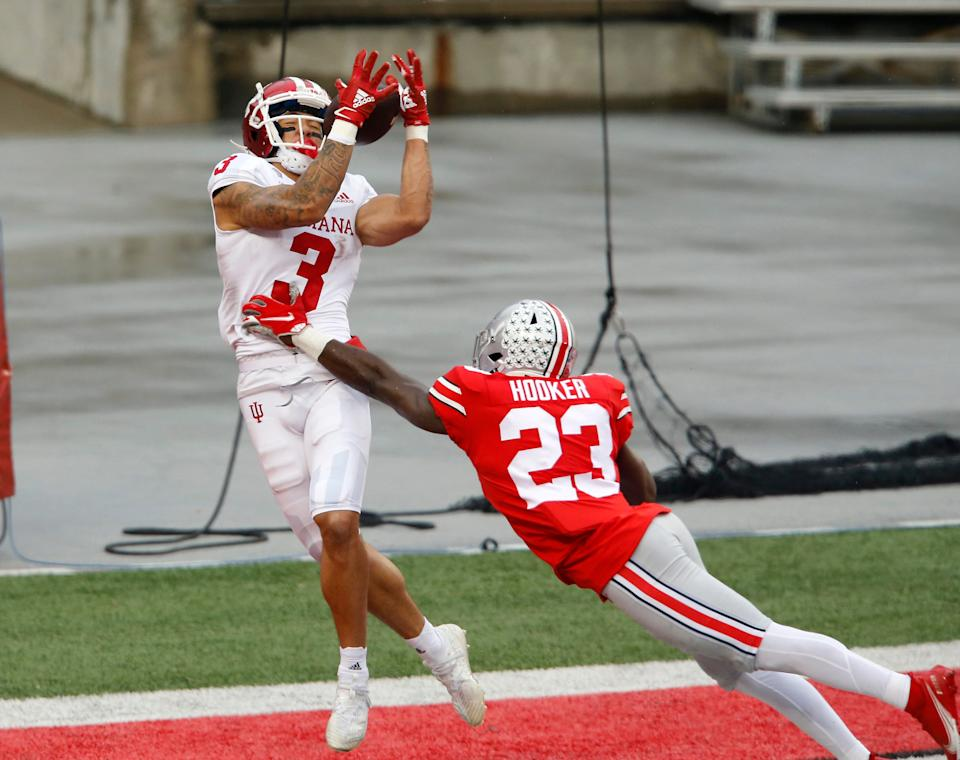 Nov 21, 2020; Columbus, Ohio, USA; Indiana Hoosiers wide receiver Ty Fryfogle (3) catches a touchdown as Ohio State Buckeyes safety Marcus Hooker (23) defends during the third quarter at Ohio Stadium.