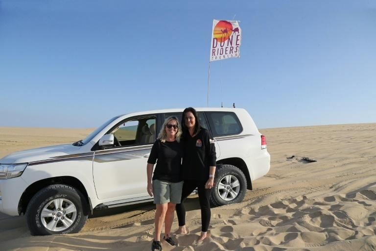 """South African Marcelle Visser (L) says she fell in love with the desert """"as soon as my tyres touched the sand"""""""