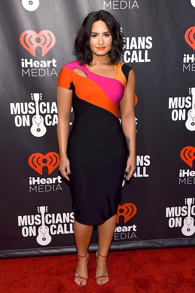 """<p>Lovato was spotted at several events this week, butwe really loved the colorful Mugler frock (and bright orange lips!) she wore to """"A Night to Celebrate Elvis Duran"""" in New York. Bold <em>and</em> beautiful! (Photo: Dimitrios Kambouris/Getty Images) </p>"""