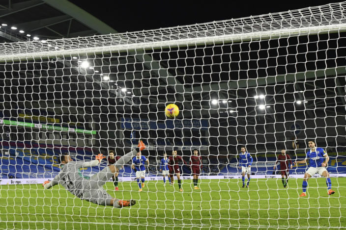 Brighton's Neal Maupay, right, scores his side's second goal from a penalty kick during the English Premier League soccer match between Brighton and Wolverhampton Wanderers at the Amex stadium in Brighton, England, Saturday, Jan. 2, 2021. (Mike Hewitt/Pool via AP)