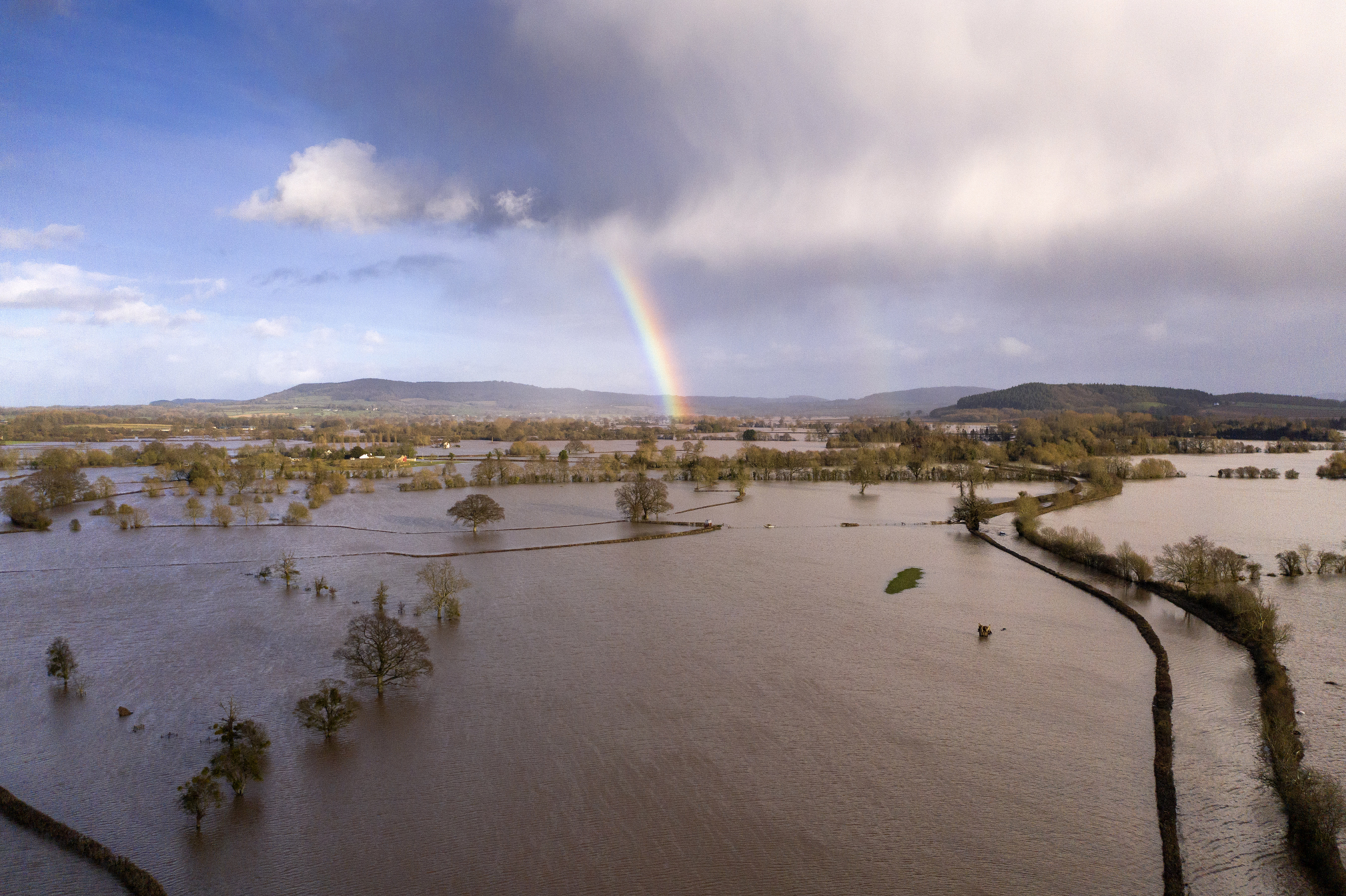 HEREFORD, ENGLAND - FEBRUARY 17: A rainbow appears over flooded fields in the Wye Valley, near the hamlet of Wellesley, following Storm Dennis on February 17, 2020 in Hereford, England. Storm Dennis is the second named storm to bring extreme weather in a week and follows in the aftermath of Storm Ciara. (Photo by Christopher Furlong/Getty Images)