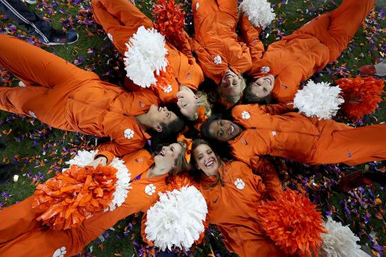 Clemson Tigers cheerleaders celebrate in confetti after the Clemson Tigers defeated the Alabama Crimson Tide 35-31 in the 2017 College Football Playoff National Championship Game at Raymond James Stadium on January 9, 2017 in Tampa, Florida.